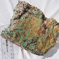 Malachite and limonite coated fractures in Quartz Monzo
