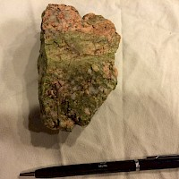 Epidote replacement of potassic altered Quartz Monzonite